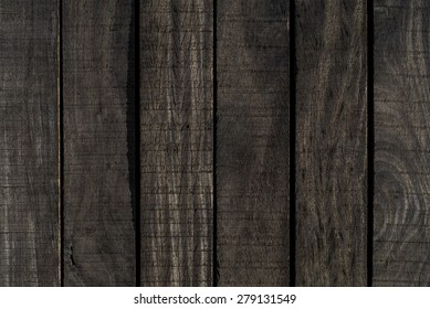 Texture of dark wooden boards on close-up, from a deck/pier, Sao Sebastiao, Sao Paulo, Brazil