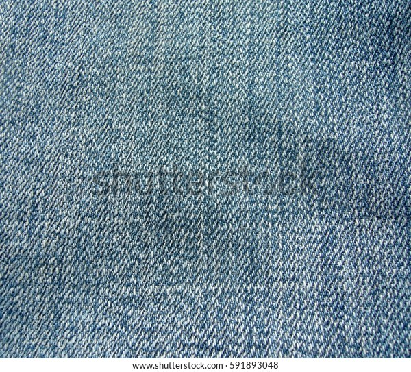 Texture denim. Blue jeans. The texture of the cotton fabric.
