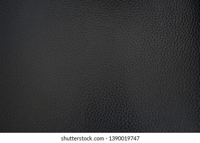 Texture of dense black leather. Vintage. Classic black color. close-up. Template for cards.