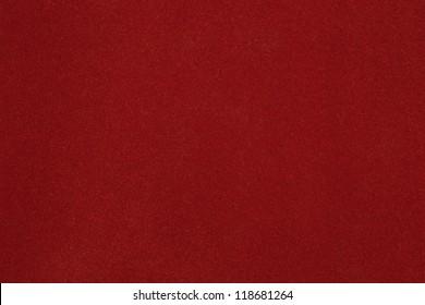 Texture of dense cardboard with vinous velvety  coating