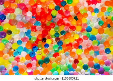 The texture is a lot of different color balls. Set of multi-colored orbeez.Orbeez Water Beads for Play. Many multicolored orbits, helium balls