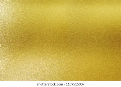 Texture of dirt stains on gold metal, abstract background
