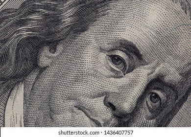 Texture of dollar bills. One hundred dollars. Close-up, macro.