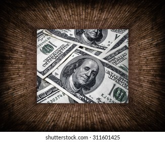 texture of dollars placed in a wooden frame