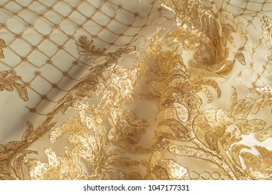 Texture. Drawing. background. lace of gold color with sparkles. Golden Beaded Lace Fabric Flower Embroidered Tulle Double-Sided Toothed Wedding Suit Gold Thread Cord