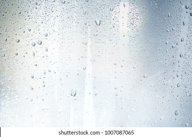 texture of a drop of rain on a glass wet transparent background