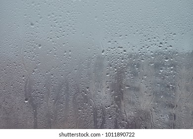 Texture of a drop of rain on the glass. Transparent background.