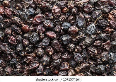 Texture of dry  barberry closeup, spice or seasoning as background. Organic food, healthy lifestyle, space for text. Top view,  Flat lay