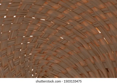Texture of dry fan palm, Licuala paludosa or Licuala sqinosa, leaf weave into the fan. for background