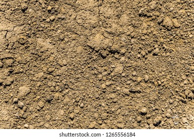 Texture of dry orange clay soil (red clay ground). Flat surface.