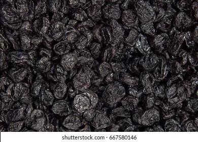 texture dry prunes closeup, food background