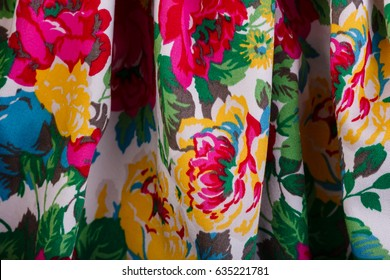 Texture of a fabric in a flower. Close Up of retro tapestry fabric pattern with classical image of the colorful floral ornament. Fragment of colorful retro tapestry textile pattern.