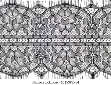 The texture of fabric lace.  Texture lace fabric. lace on white background studio. thin fabric made of yarn or thread. typically one of cotton or silk, made by looping, twisting,