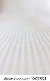 Texture of fabric surface for abstract backgrounds of white color; soft focus