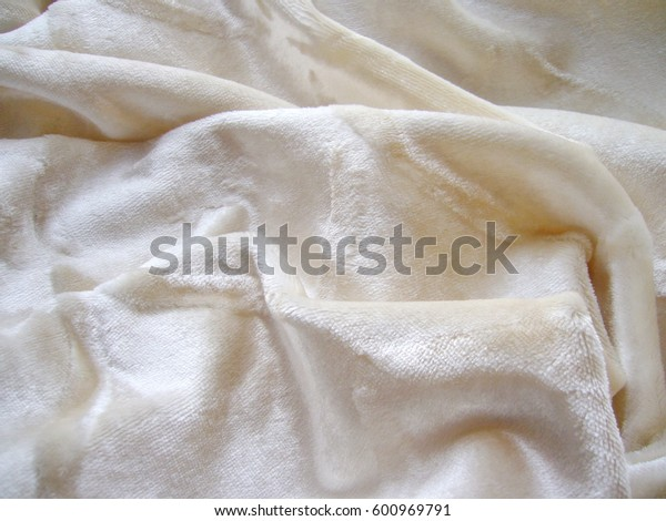 Texture of fabric. Velor, velvet, plush, terry cloth. White fabric.