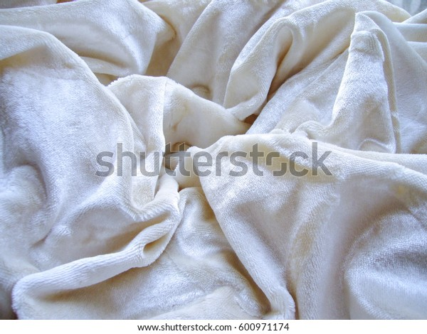 Texture of fabric. Velor, velvet, plush, terry cloth. White fabric. Elegant, curtains