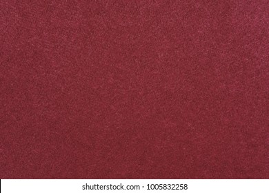 texture of fabric of a velvet of red crimson color for an abstract background or for wallpaper