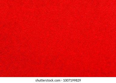 texture of fabric of a velvet of red scarlet color for an abstract background or for wallpaper