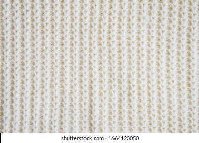The texture of the fabric. White knitted pattern. background.