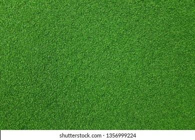 Texture of fake green grass for background or backdrop.