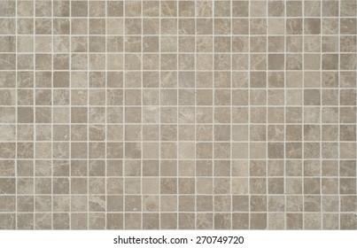 Texture of fine ceramic tiles cream and brown.