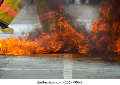 Texture of fire background. Fire flames using as a background or wallpaper. People using fire extinguisher fighting fire closeup photo.