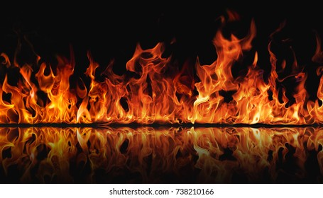 The texture of fire on a black background is reflected in a glossy table.