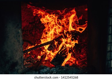The texture of the fire. Uzbek oven for cooking pilaf. Kazakh tandoor for cooking. Flames on a dark background