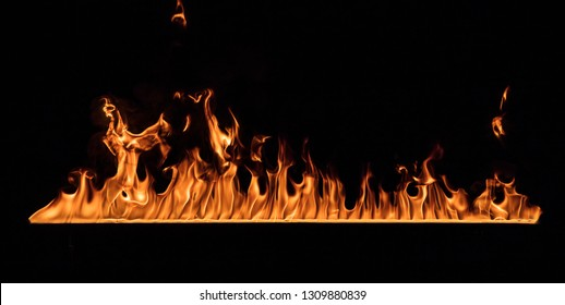 Texture of fire wall isolated on a black background.