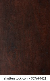 Texture of flat dark wood background. Patterm of brown wood close-up