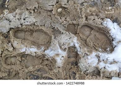 Texture. footprint of shoes in muddy slushy snow.