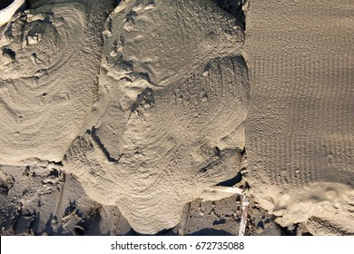 The texture of the fresh liquid cement. A background of rough hard concrete. Gray cement screed. Concept construction, repair. Place for text.