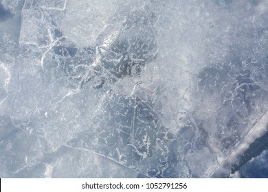 texture of frozen water in the winter lake