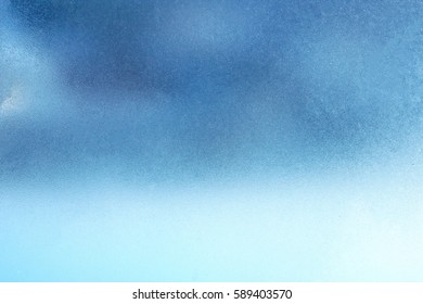 Texture of frozen window glass, heavy frost and cold, can be used as a background image in cool colors