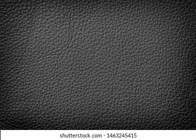 Texture of genuine leather close-up, cowhide. Black color. For natural, artisan backgrounds, substrate composition use, vintage design. Concept of shopping, manufacturing