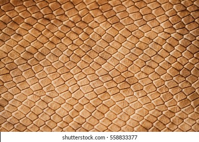 Texture of genuine leather close-up, with embossed scales  reptiles, the trend pattern