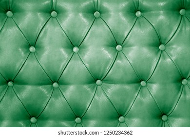 Texture of genuine mint green  leather upholstered furniture. Decorative background of genuine quilted leather capitone texture