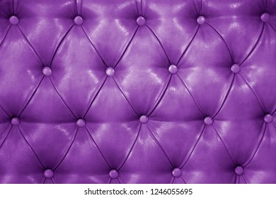 Texture of genuine purple leather upholstered furniture. Decorative background of genuine quilted leather capitone texture