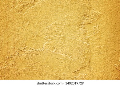 Texture gold cement wall in rough patterns abstract for background