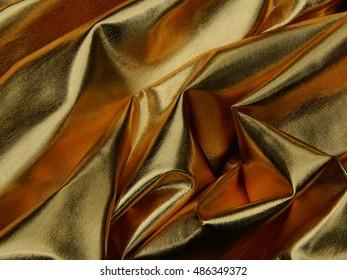 Texture of golden material satin close up