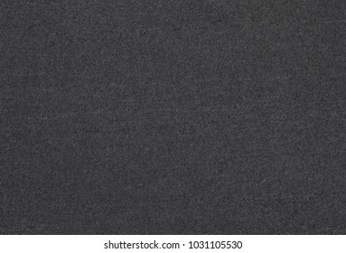 The texture of the gray carpet.