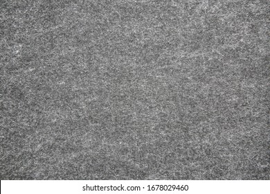 Texture of gray felt fabric. Grunge background.