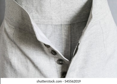 Texture of gray linen. Historic linen shirt for horse riding.clothes on a mannequin