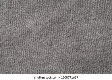 Texture of a gray old jeans fabric.