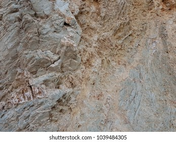 The texture of the gray stone of different structures. Photo surface of the rock.