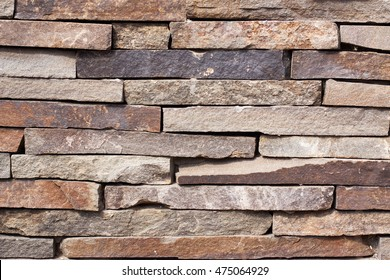The texture of the gray stonework. The wall built of rectangular stones. Space for text. The concept of reliability, construction, good home, hearth