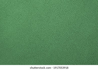 texture of green non-uniform fleece cotton fabric