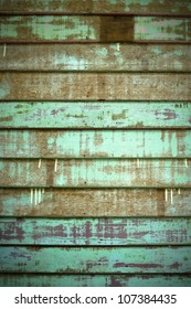 Texture of Green Old Cracked wood Plank wall