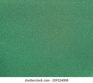 Texture of a green woven synthetic waterproof fabric