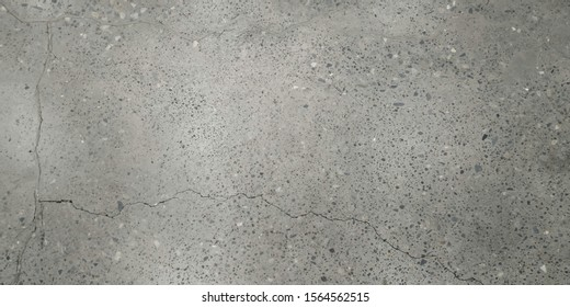 Texture of grey granite plate with cracked surface. Background pattern.Cracked wall. Crack Concrete floor with texture.